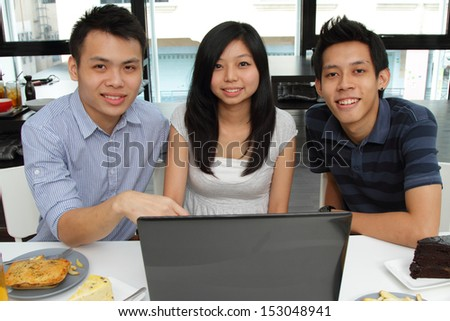 A group of friends at a cafe - stock photo