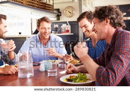 A group of friends having lunch in a restaurant - stock photo