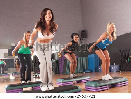 a group of friends in a step fitness class - stock photo