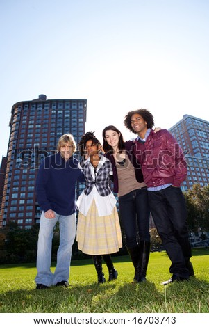 A group of friends in an urban setting - stock photo