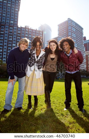 A group of friends in the city similing at the camera - stock photo