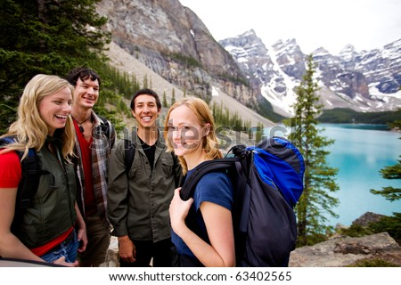 A group of friends on a hiking / camping trip in the mountains - stock photo