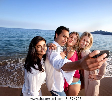 A group of friends taking a self portrait - room for copy space at top - stock photo