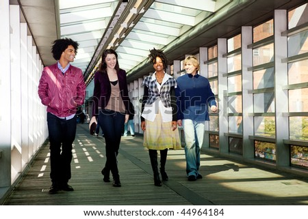 A group of friends walking in an urban setting - stock photo