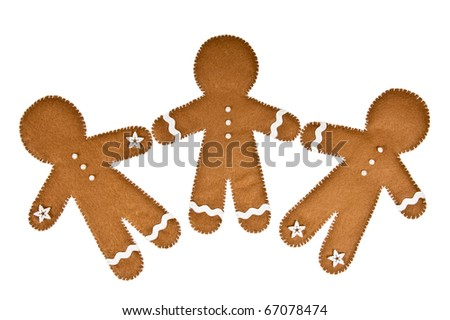 a group of gingerbread men made of felt
