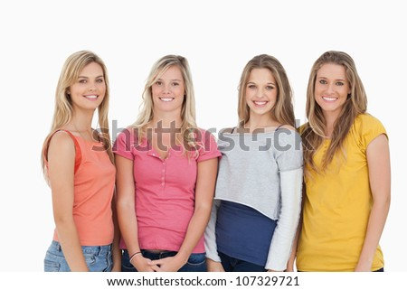 A group of girls smiling as they look at the camera together - stock photo