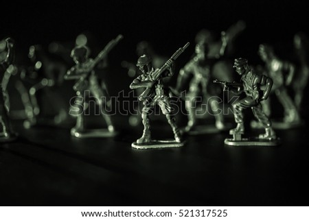 A group of green plastic toy soldiers, Concept idea of World War 2