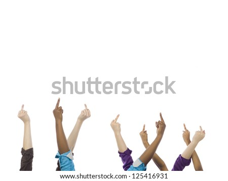A group of hands raising their middle finger over the white surface
