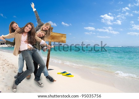 A group of happy celebrating women in an exotic travel background - stock photo