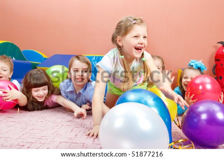 A group of happy kids playing with colorful balloons - stock photo