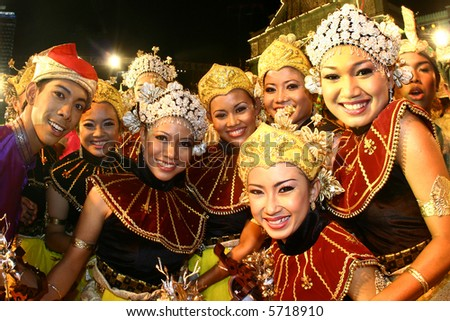 A group of happy Malay traditional dancer with traditional dress. - stock photo
