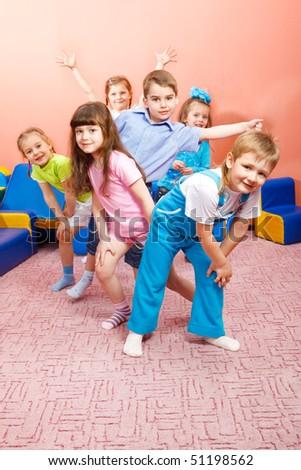 A group of happy preschool kids - stock photo