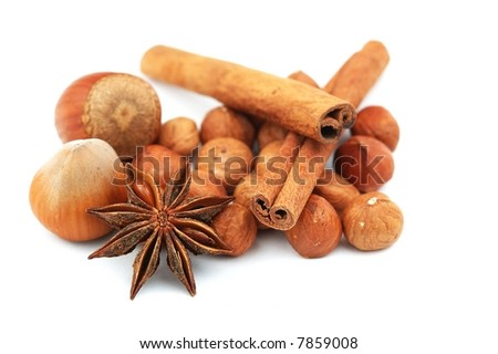 A group of hazelnuts, anise and cinnamon isolated on white background