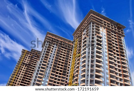 A group of high rise colorful residential apartments - stock photo