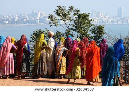 A group of indian women looking at the skyline of mumbai - stock photo