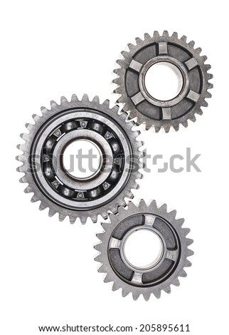 A group of interlocking transmission gears on a white background. - stock photo