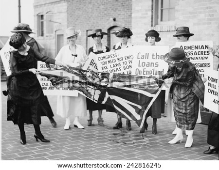 A group of Irish-American women tearing up a British flag, as they protest against United States support of the English against the Irish Independence. Washington, D.C., June 3, 1920 - stock photo
