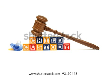 A group of isolated objects in regards to the concept of child custody. - stock photo