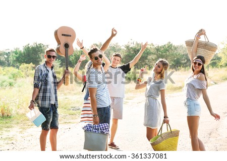 A group of joyful friends having fun outdoors - stock photo