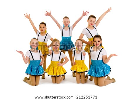 A group of junior jazz dancers in recital costume - stock photo