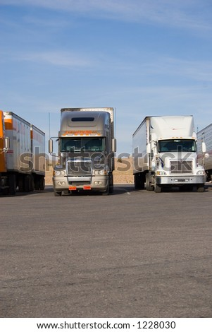 a group of large trucks in a row - stock photo
