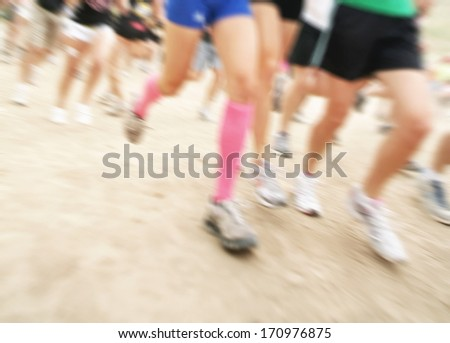 a group of legs running with a motion blur - stock photo