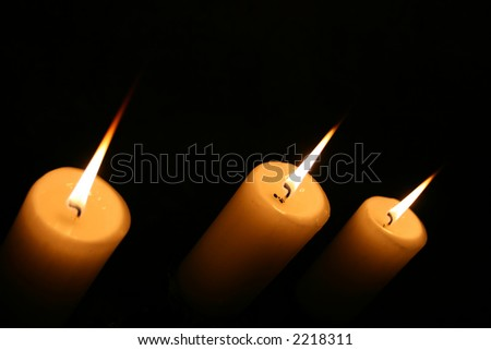 A group of lit candles seen from above.