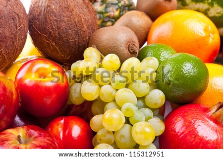 a group of many whole fruits - stock photo