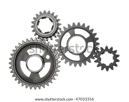 A group of metal gears linked together, isolated on a white background. - stock photo