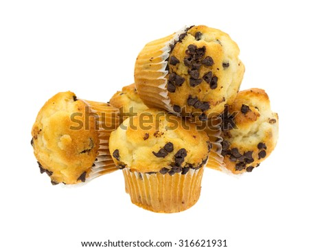 A group of mini chocolate chip muffins stacked on a white background. - stock photo