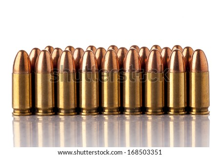 A group of 9mm bullets for a a gun isolated on a white background - stock photo
