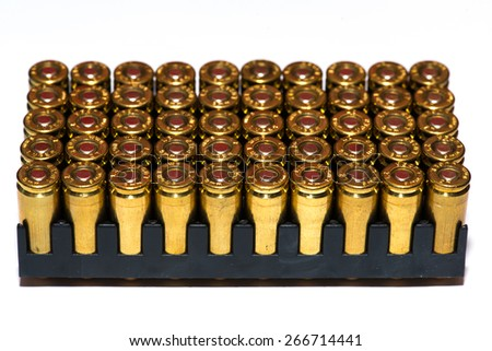 A group of 9mm bullets for a gun isolated on a white background - stock photo