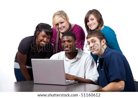 A group of multi-racial college students/friends sitting around a computer - stock photo