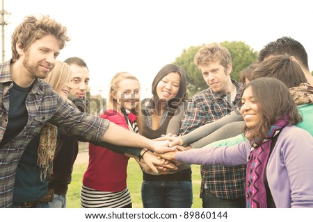 a group of multiracial students whit hands on stack - stock photo