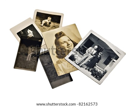 A group of old family photos and negatives on white background.