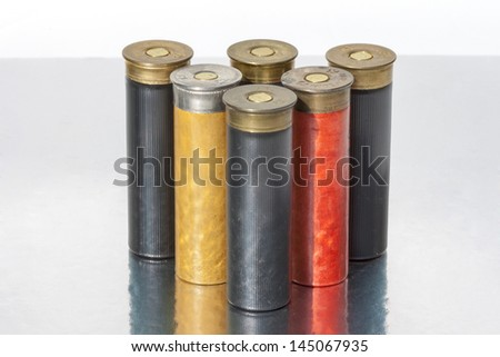 A group of old shells for a 12 gauge shotgun - stock photo