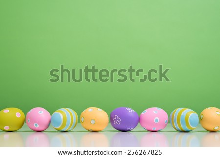 A group of Painted Easter eggs with copy space - stock photo
