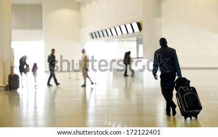 A group of people at the airport. Blurred motion. - stock photo