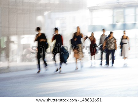 A group of people. Blurred motion.  European Parliament