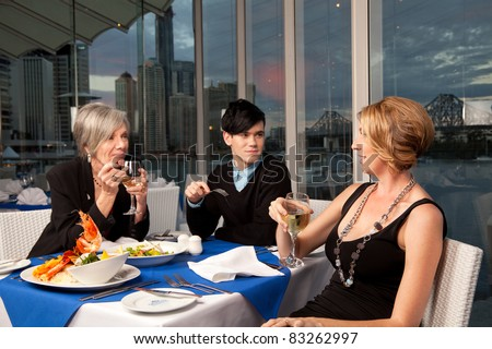 A group of people enjoying a meal - stock photo