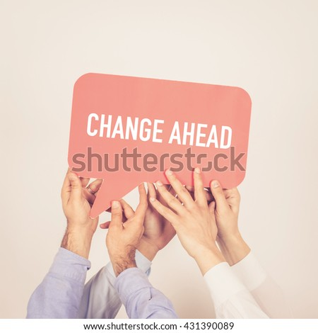 A group of people holding the Change Ahead written speech bubble - stock photo