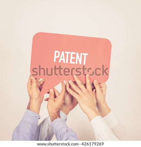 A group of people holding the Patent written speech bubble - stock photo