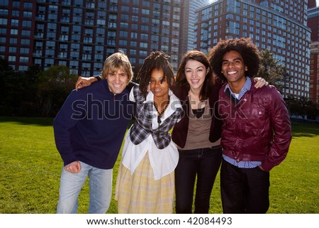 A group of people in front of an apartment building taken into the sun with solar flare
