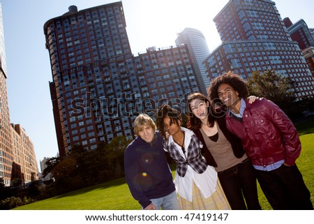 A group of people in front of an apartment building taken into the sun with solar flare - stock photo