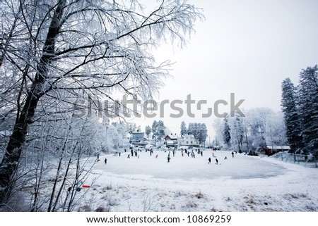 A group of people skating on a local rink - stock photo