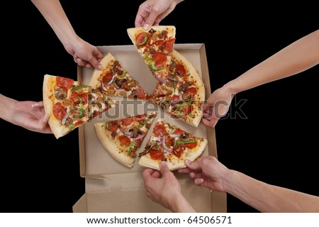 A group of people taking slices of pizza - stock photo