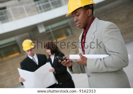 A group of people working as  architects on a construction site - stock photo