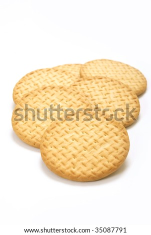A group of plain tea biscuits on white background
