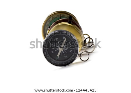 A group of pocket compass against the white background - stock photo