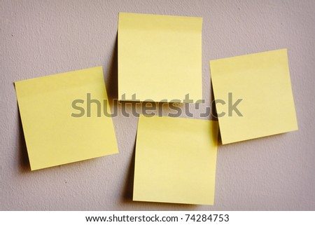 A group of post-it notes on the wall - stock photo